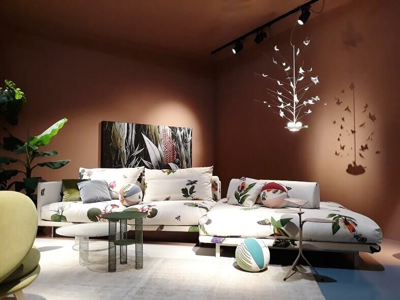 designer sofas with floral fabric,nature inspired living room decor,butterfly themed chandeliers,salone del mobile milano trends,green and white coffee tables,