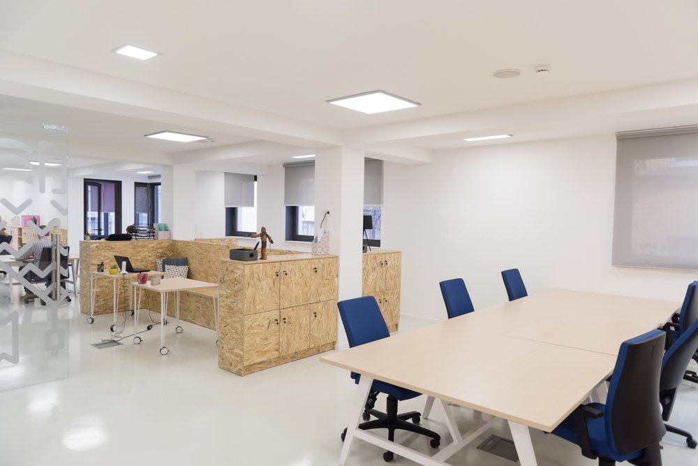 office space dividers ideas,modern office design,wood office cabinets with doors,blue office chairs with arms,workplace design,