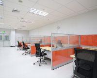 orange partitions for office cubicles,orange office color schemes,white walls modern architecture,black work desk chair,modern office design,