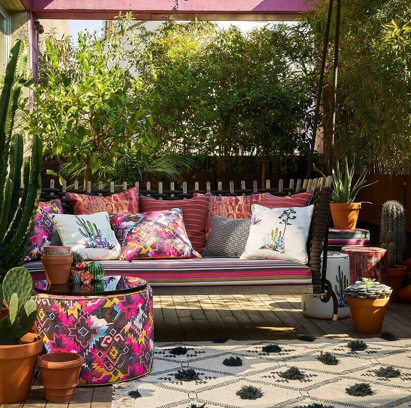 colorful decorative cushions for terrace,decorating with fabric ideas,how to decorate a terrace beautifully,caribbean inspired home decor,colorful terrace decorations,
