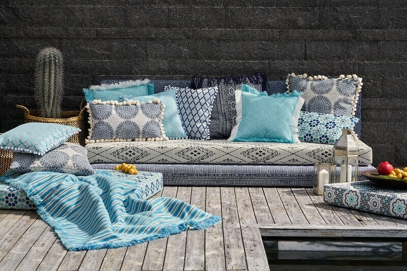 how to decorate a terrace beautifully,oriental inspired home decor,colorful terrace decorations,colorful decorative cushions for terrace,decorating with fabric ideas,
