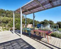 designer outdoor dining furniture,mediterranean outdoor dining area,modern villa design exterior,colorful outdoor dining chairs,terrace wood floor ideas,