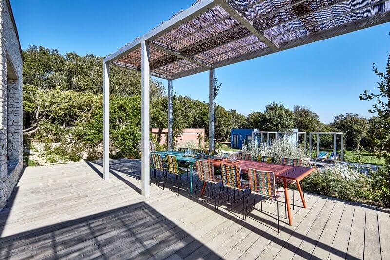 modern villa design exterior,colorful outdoor dining chairs,terrace wood floor ideas,designer outdoor dining furniture,mediterranean outdoor dining area,