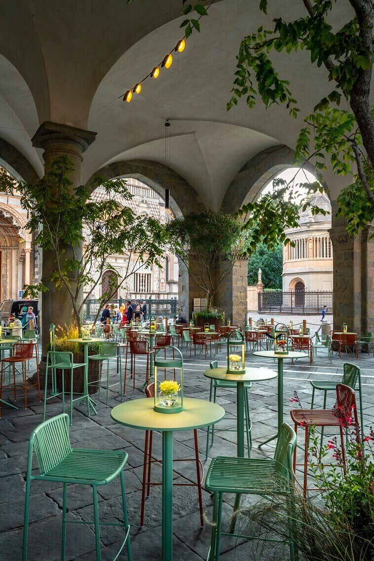 designer table lamps for outdoors,italian historical architecture,contemporary garden dining chairs,orange and green furniture,outdoor table lighting ideas,