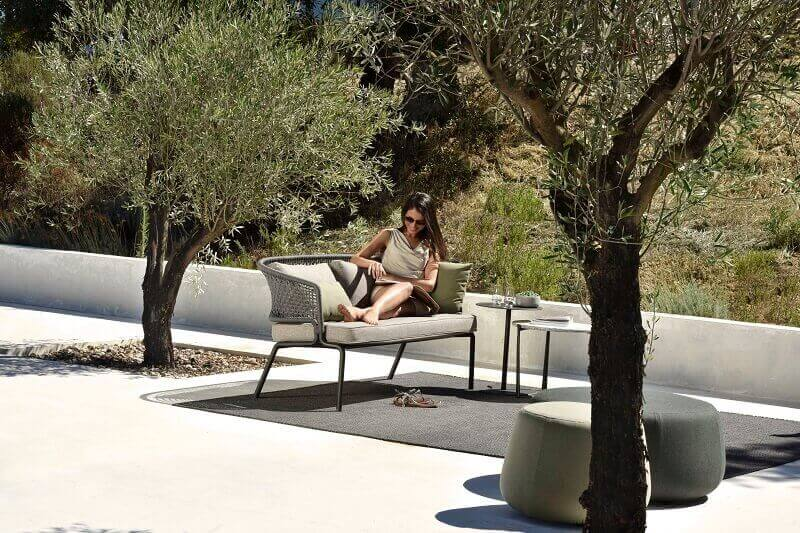 outdoor two seater with table,tribu outdoor chairs,olive tree on terrace,home office on the terrace,woman reading on a terrace,