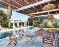 aw2 architects paris,outdoor seating made from pallets,colorful outdoor seat cushions,rustic outdoor pool lounge furniture,bamboo garden lanterns,