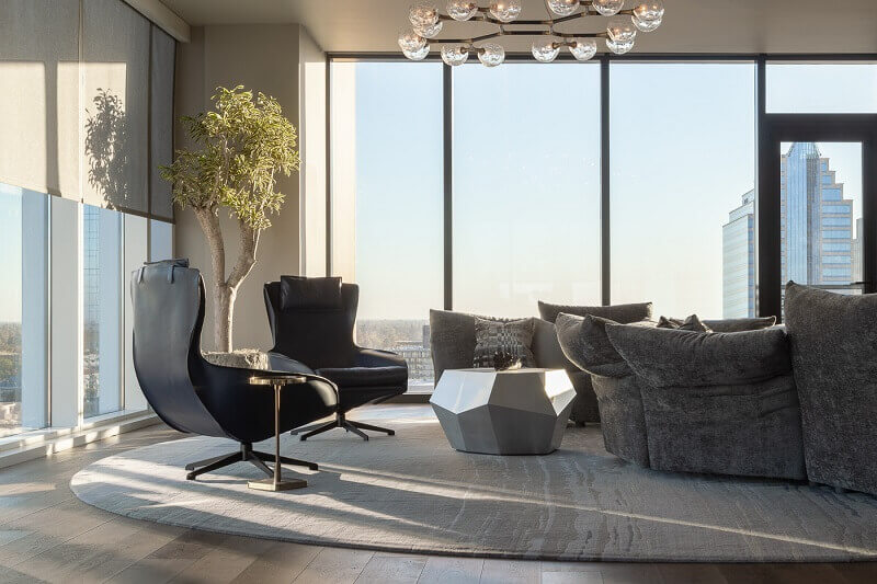 penthouse interior design,decorating living room with a view,penthouse in sacramento,Mario Bellini lounge chairs,brabbu horus suspension light,