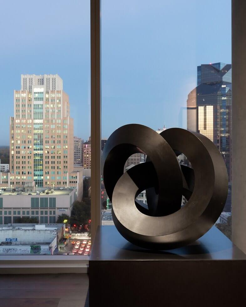sculpture bronze design,apartment with a city view,the view from the penthouse,artistic penthouse design ideas,artwork in interior design,