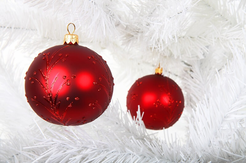 red baubles on white Christmas tree,Christmas tree in dining room or living room,living room Christmas tree ideas,red white interior decorating,red and gold baubles,
