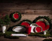 how designers decorate for holidays,red and green table plates,natural table centerpiece ideas,table centerpieces made of branches,traditional table setting ideas,