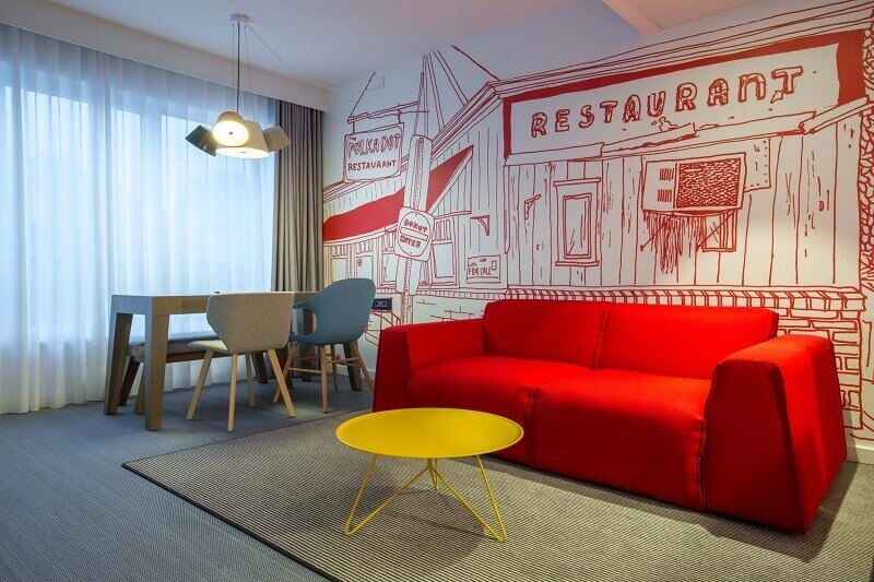 red designer modern sofa,wallpaper living room design,milano bedding red parker,red sofa yellow coffee table,designer living and dining room together,