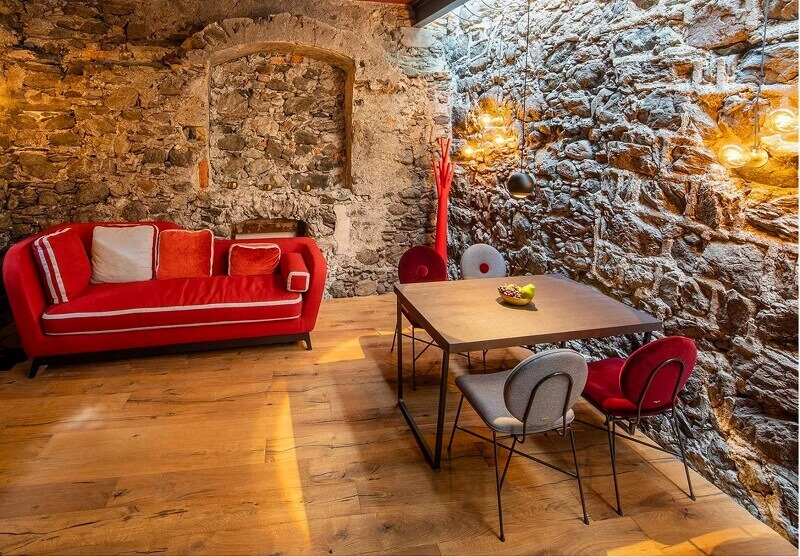 red sofa bed in dining room,dining room ideas with stone wall,milano bedding jeremie,red and white velvet couch,modern sofa bed italy,