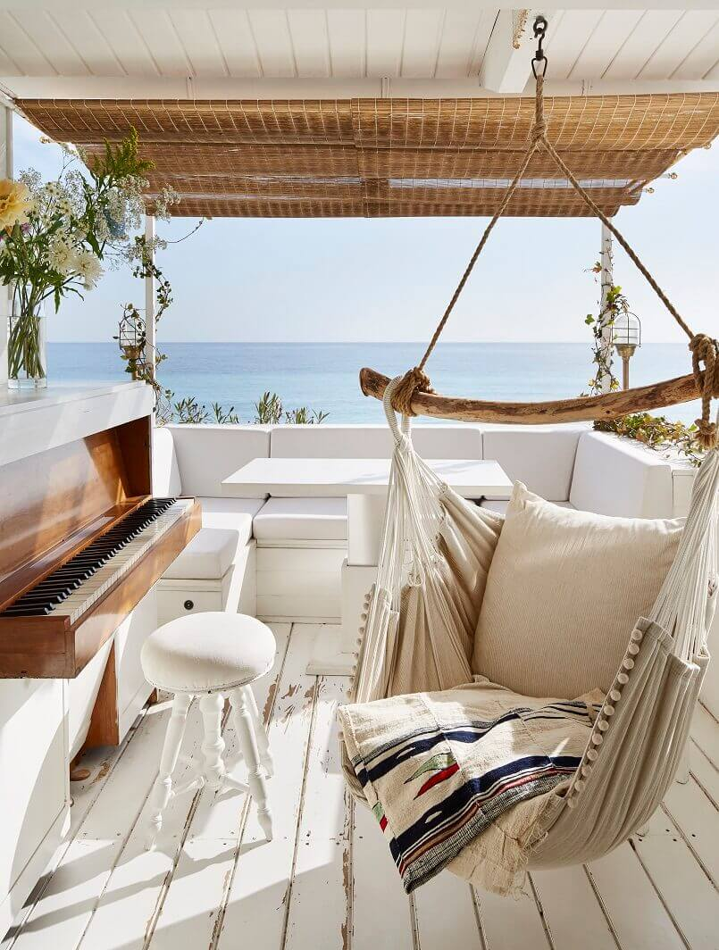 design ideas for outdoor living spaces,covered outdoor living spaces,terrace with piano and hammock,terrace decor in neutral colors,how to create a cozy outdoor space,