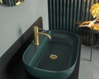 green bathroom sink ceramic,colorful wash basin,green washbasin ceramic,scarabeo ceramiche srl fabrica di roma,green bathroom sink with gold taps,